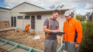 Todd Fiedler from Fiedler Brothers Plumbing speaking with staff member Andrew Burton on site in Kingaroy. Picture by Paul Harris.